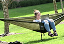 A student studies in a hammock at The University of Akron