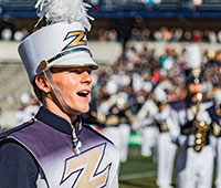 A member of the marching band who is taking classes at The University of Akron