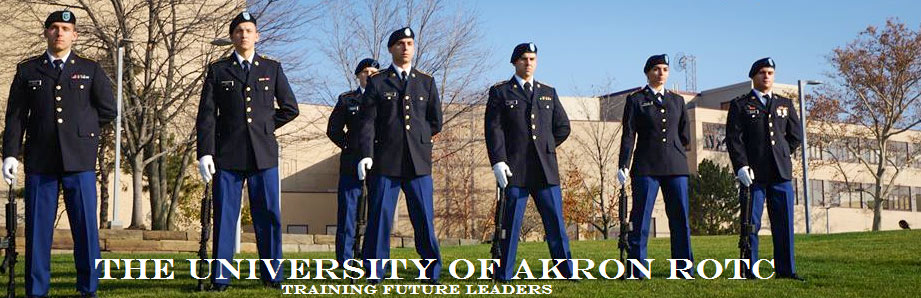 Cadets in uniform stand at attention on The University of Akron campus