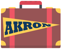 A suitcase with an Akron pennant on it