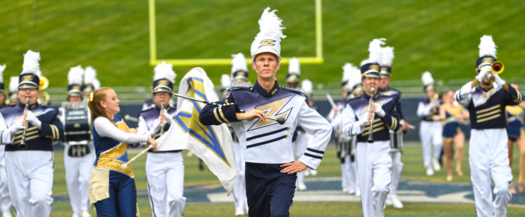 The University of Akron Marching Band performs at a football game