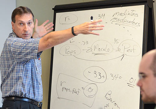 A psychology professor gestures during a lecture