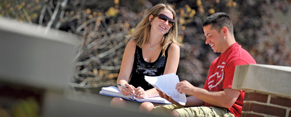 Students sharing a laugh on The University of Akron campus