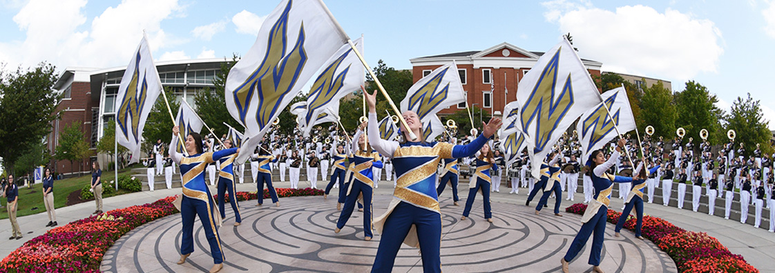 The marching band performing on Coleman Common at the University of Akron