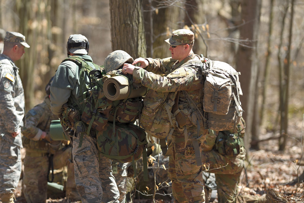 A student assists a teammate in conducting pre-execution checks