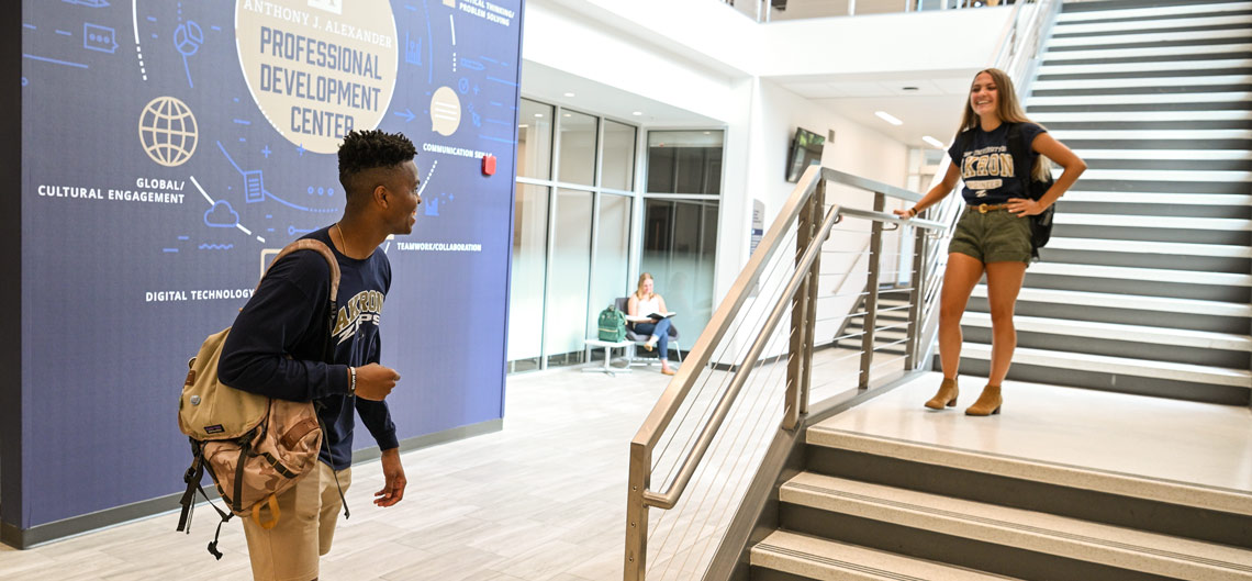 Two students talk inside the business school's new Professional Development Center