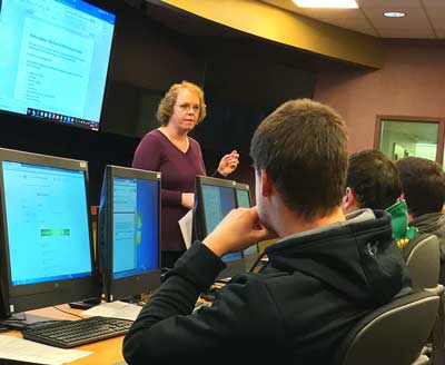 Students in a lecture in The University of Akron's risk management program