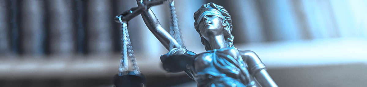 Picture of a blind Lady Justice holding up the scales of justice, header for criminal justice at The University of Akron.