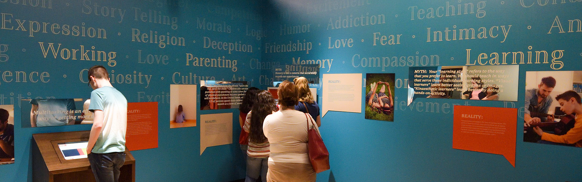 museum guests exploring what makes us human