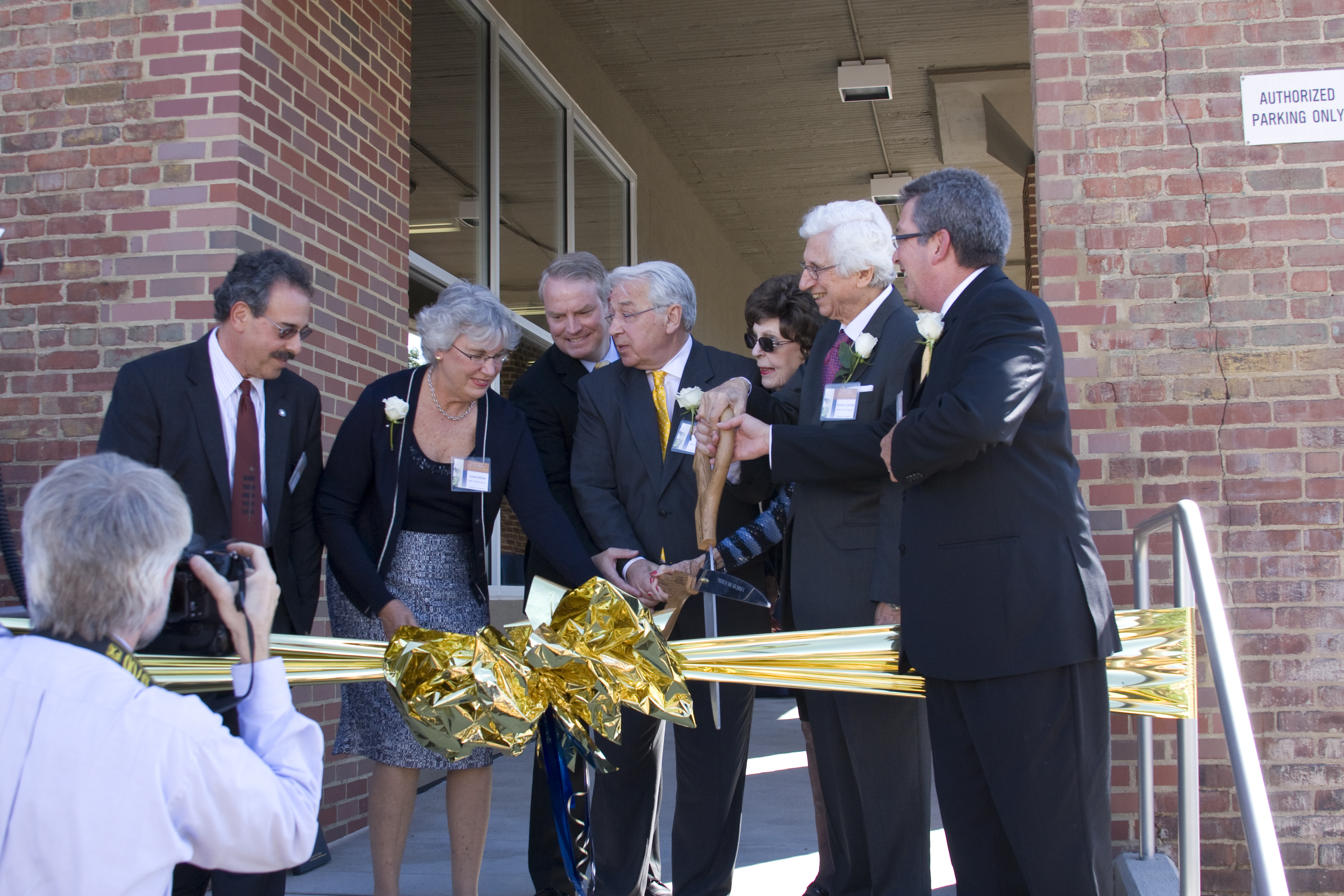 Dr. Baker, Drs. Nicholas Dorothy Cummings and others cutting the ribbon to the museum