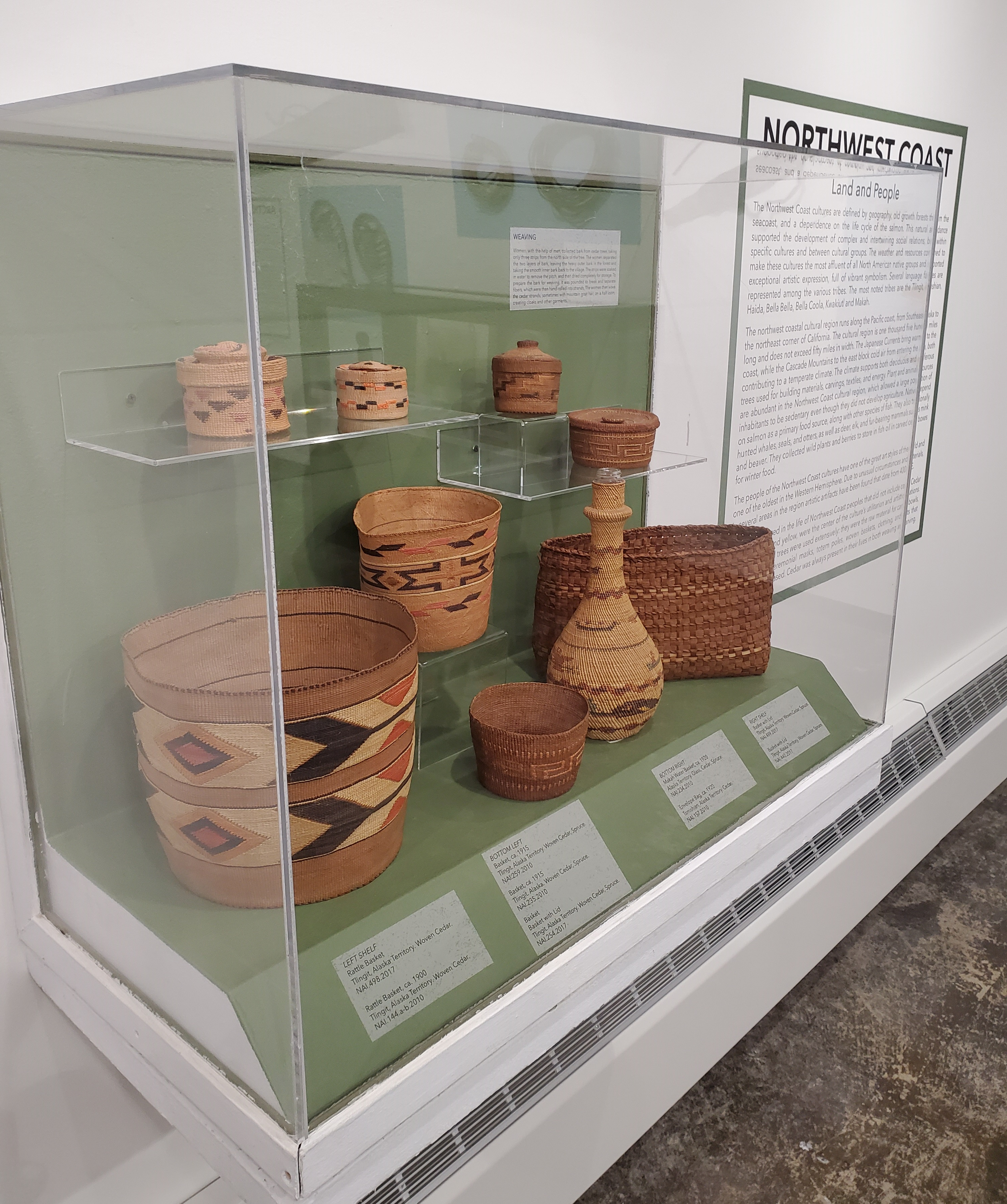 Display case from the Oak Native American Gallery featuring baskets and woven artifacts