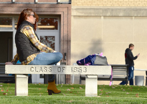 A student relaxes near Leigh Hall on The University of Akron campus