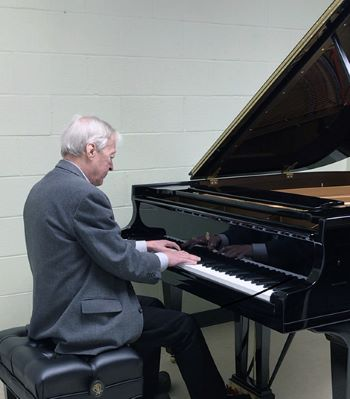 Philip Thomson, associate professor of piano and chair of Piano Studies, plays the new Steinway for the first time.