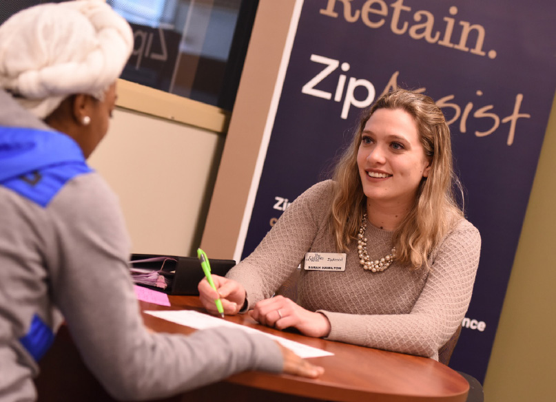 Sarah Hamilton helps a University of Akron student seeking support from ZipAssist