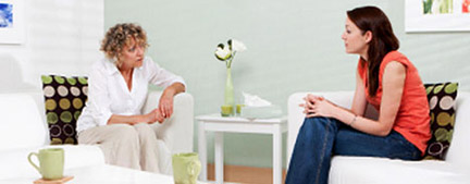 A counselor and patient in a mental health therapy session