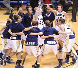 The women's basketball team huddles just before tipoff in Rhodes Arena at The University of Akron