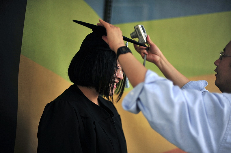 A Williams Honors College student prepares for commencement at The University of Akron
