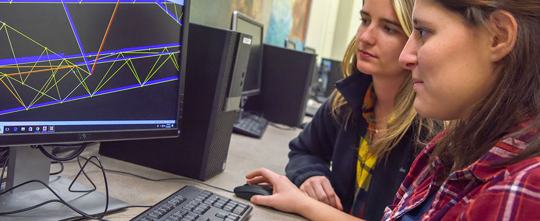 Civil engineering student at The University of Akron work on a project