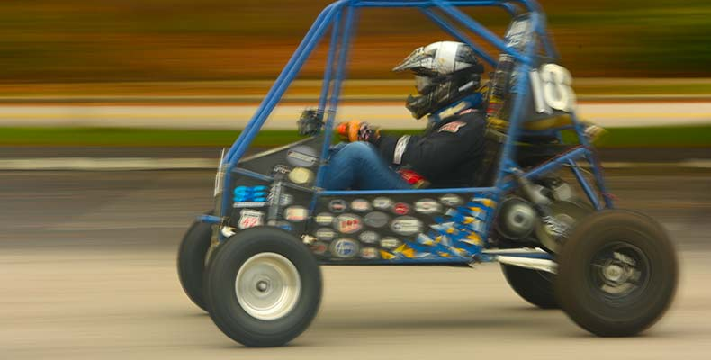 A student tests a baja car at The College of Engineering at The University of Akron.