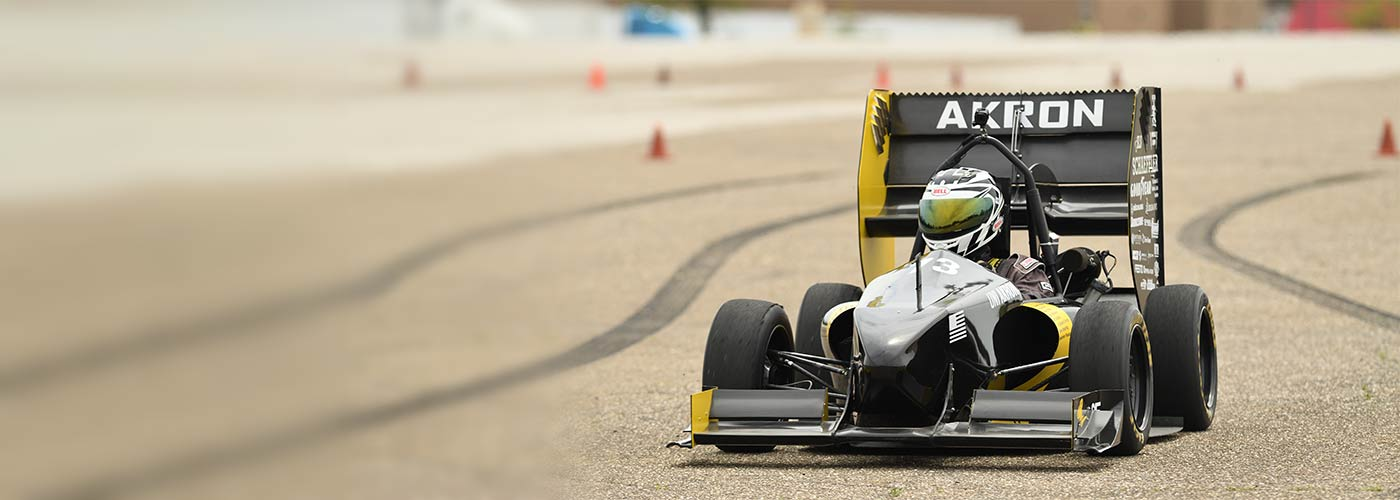 A student-designed race car on the track