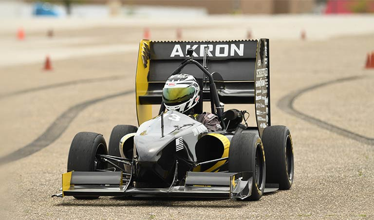 A student-designed car on a track