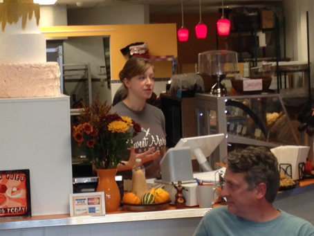 Mary Hospodarsky, owner of Sweet Mary's Bakery, speaking with students and community members at her downtown Akron restaurant (also pictured, Kyle Julien of the East Akron Neighborhood Development Corporation).