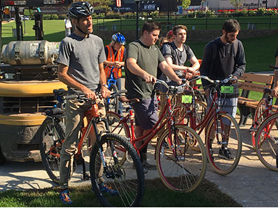 Professor and students on bicycles