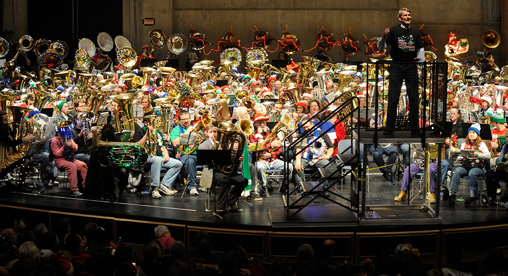 TubaChristmas performers with Tucker Jolly on platform