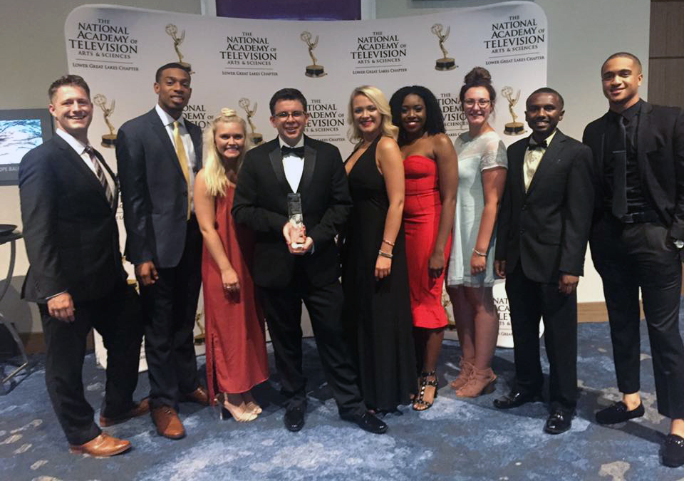 Students and faculty from the School of Communication accept an Emmy Award in 2015