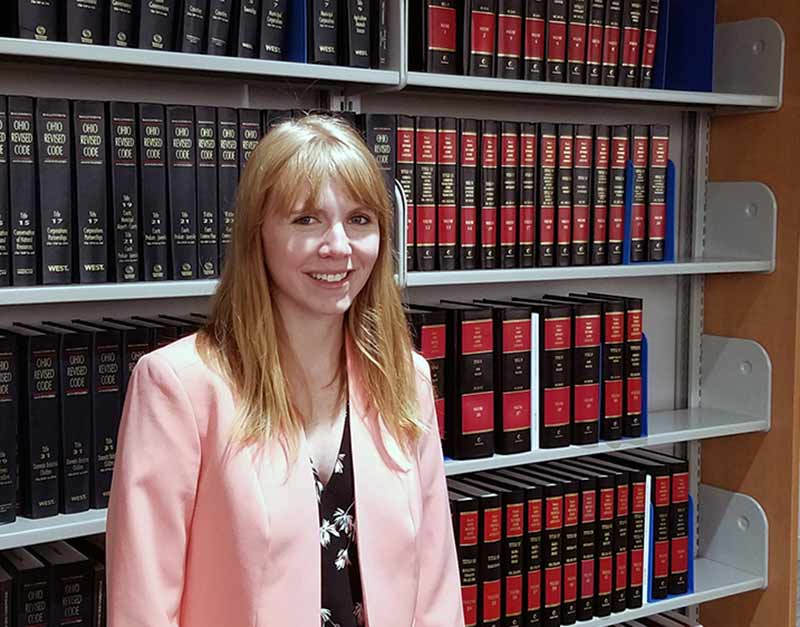 University of Akron School of Law student Ashley Lanz in the school's law library