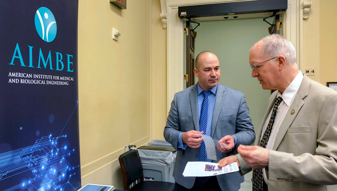 The University of Akron's Matthew Becker discusses his research team's work on non-opioid pain management with U.S. Rep. Bill Foster