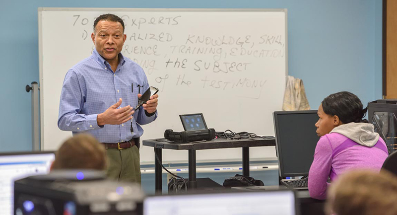 A cybersecurity professor leads a class