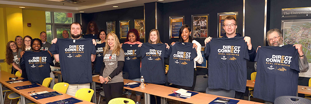 Students holding Direct Connect T-shirts