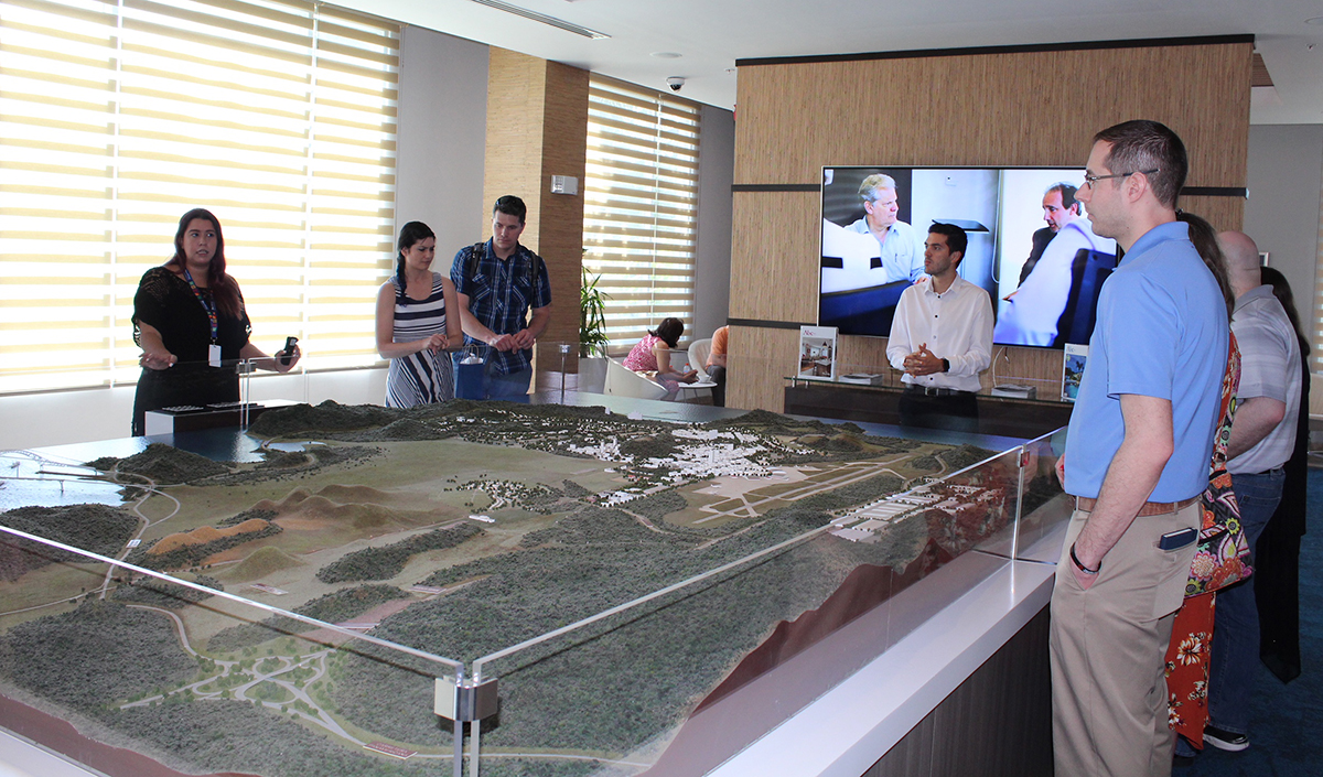 MBA students with diorama of Panama Pacifico