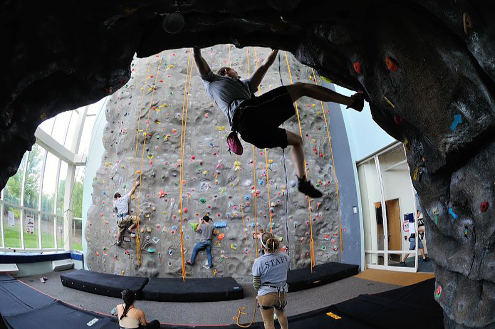 Climbers on rock wall