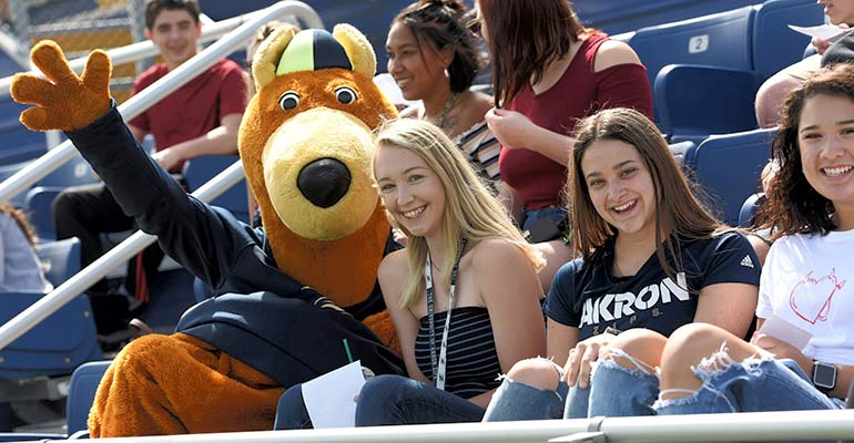 Zippy welcomes a new student to The University of Akron