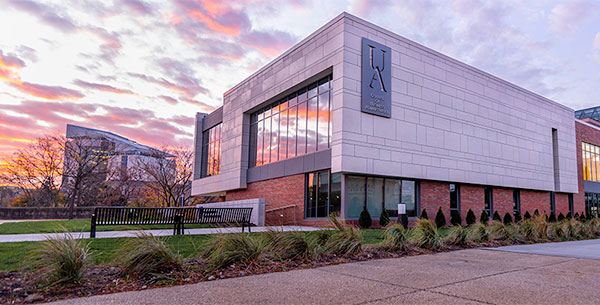 Exterior of the business school at sunrise