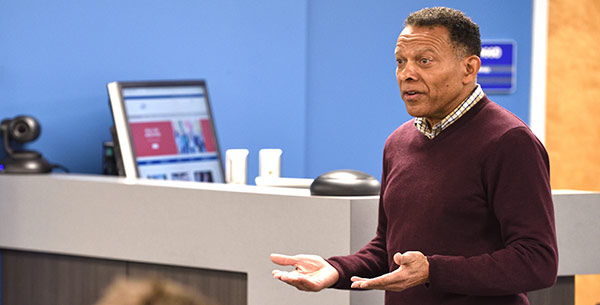 A cybersecurity professor leads a class of students through an exercise