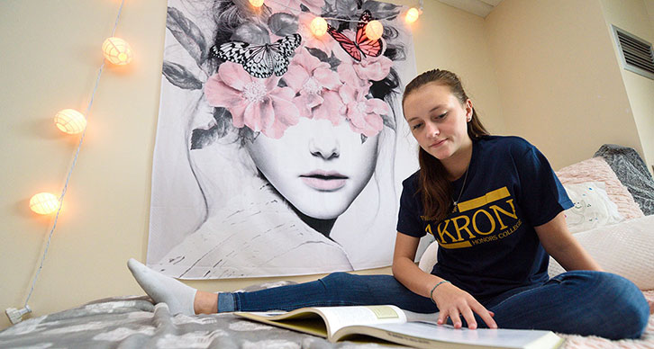 A student studies in her dorm room at The University of Akron