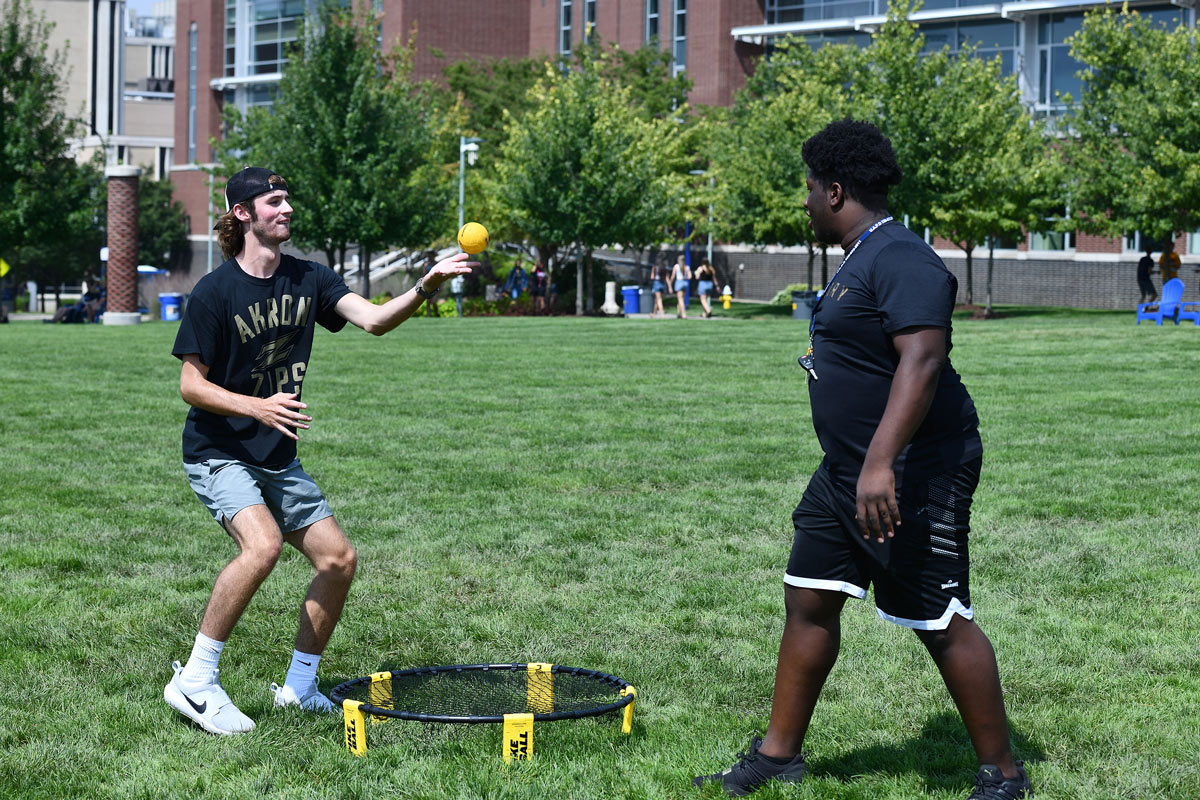 Two students play a game in Coleman Common