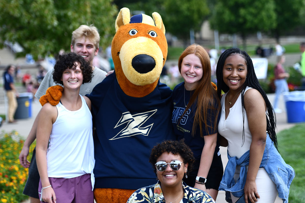 Zippy poses with students