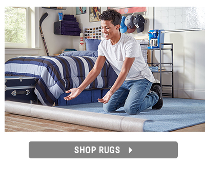 Shopping for dorm essential rugs.