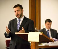 An Akron Law student in moot court, practicing his skills