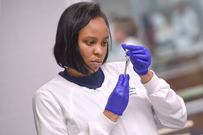 A nursing student in a lab at The University of Akron
