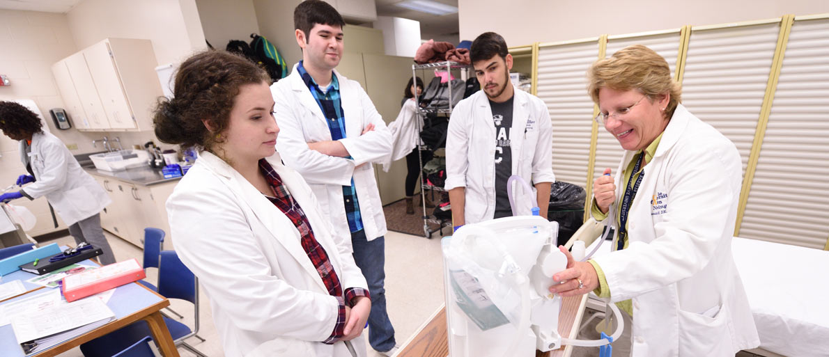 Nursing students in a lab at The University of Akron