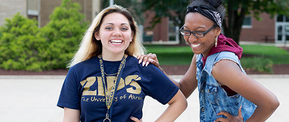 Two Akron Rises Scholars enjoy a laugh on campus between classes