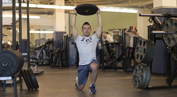 Image of person lifting a weight