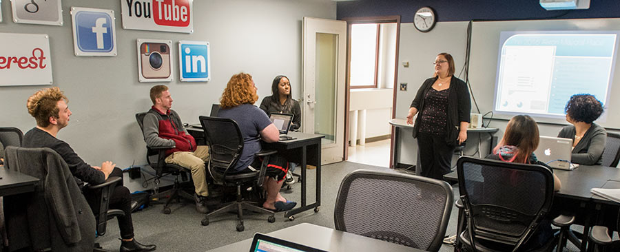 Students participating in a discussion in a social media class at The University of Akron