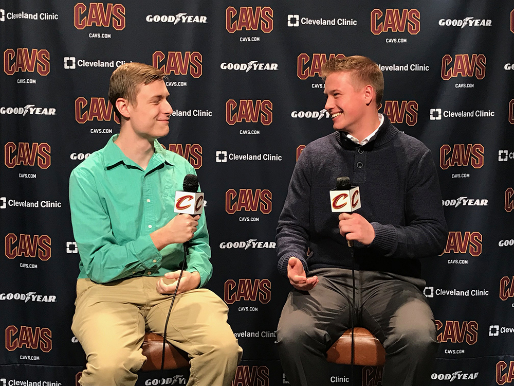 Student working at a cavs press conference