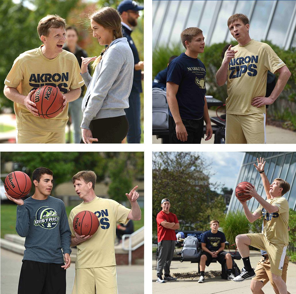 President Wilson shoots basketball with students outside of the Student Union